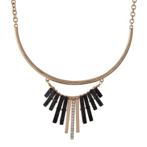 "Gold tone necklace set with black fringe. Approximately 16"" in length."