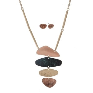 "Gold tone necklace set with a tri-tone textured pendant. Approximately 32"" in length."