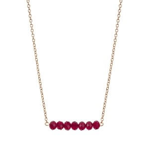 "Gold tone beaded bar necklace with maroon faceted beads. Approximately 16"" in length."