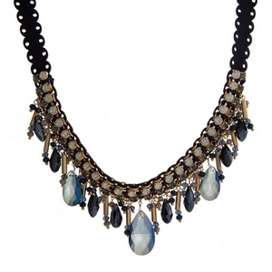 "Navy blue suede necklace with navy and white opal stones and gold tone accents. Approximately 16"" in length."