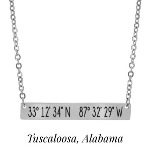 "Silver tone necklace with a bar pendant stamped with the coordinates of Tuscaloosa, Alabama. Approximately 18"" in length."