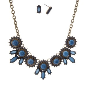 "Burnished gold tone necklace set with navy blue circle and oval stones. Approximately 16"" in length."
