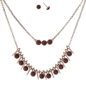 "Burnished gold tone double layer necklace set with burgundy faceted stones. Approximately 16"" in length."