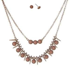 "Burnished gold tone double layer necklace set with beige faceted stones. Approximately 16"" in length."
