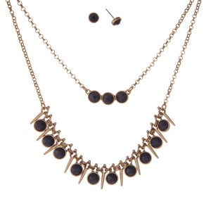 "Burnished gold tone double layer necklace set with navy blue faceted stones. Approximately 16"" in length."