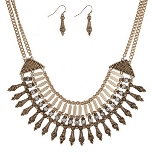 "Gold tone bib style necklace with clear rhinestones. Approximately 16"" in length."