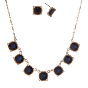 "Gold tone necklace set with seven faceted square blue stones and matching stud earrings. Approximately 16"" in length."