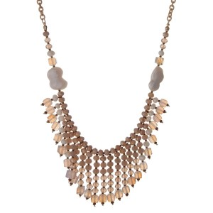 """Gold tone necklace with freshwater pearls, ivory, beige and white opal beads. Approximately 32"""" in length."""