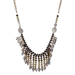 """Gold tone necklace with freshwater pearls, olive green, hunter green and white opal beads. Approximately 32"""" in length."""