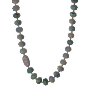 "Light and olive green beaded necklace with gold tone beads and a pave bead focal. Approximately 22"" in length."