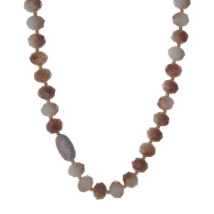 "Ivory and topaz beaded necklace with gold tone beads and a pave bead focal. Approximately 22"" in length."