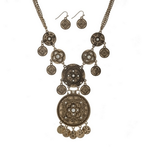 "Burnished gold tone statement necklace with hammered circle decor, accented with clear rhinestones. Approximately 18"" in length."