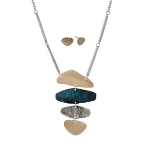 "Silver tone necklace set with a tri-tone textured pendant. Approximately 32"" in length."