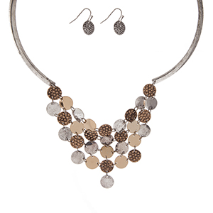 "Silver tone necklace set with a two tone bib and matching fishhook earrings. Approximately 16"" in length."