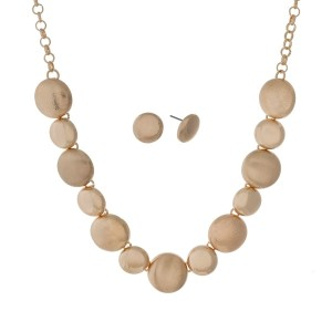 "Gold tone necklace set with textured, brushed, and shiny circles and matching earrings. Approximately 16"" in length."