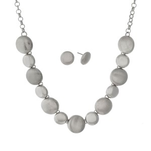 "Silver tone necklace set with textured, brushed, and shiny circles and matching earrings. Approximately 16"" in length."