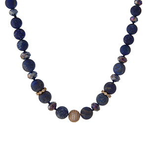 "Gold tone necklace with blue and iridescent faceted beads and lapis natural stone beads. Approximately 16"" in length. Handmade in the USA."