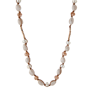 "Brown cord necklace with gold tone square beads, freshwater pearls, and champagne faceted beads. Approximately 25"" in length. Handmade in the USA."