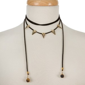 Black suede cord choker necklace with gold tone arrowheads and tiger's eye beads. Adjustable in length. Handmade in the USA.