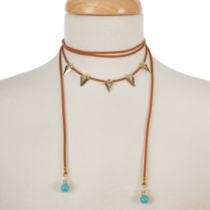 Brown suede cord choker necklace with gold tone arrowheads and turquoise beads. Adjustable in length. Handmade in the USA.