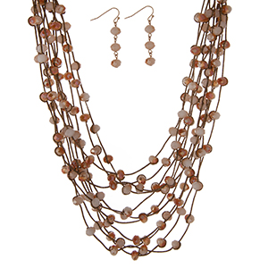 """Bronze multi strand necklace set with champagne faceted beads and matching fishhook earrings. Approximately 16"""" in length."""