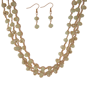 """Tan, triple row crocheted cord necklace set with light green beads and matching fishhook earrings. Approximately 16"""" in length."""