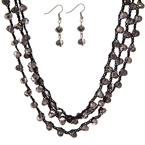 "Black, triple row crocheted cord necklace set with gray beads and matching fishhook earrings. Approximately 16"" in length."
