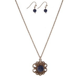 "Dainty gold tone necklace set with a flower pendant, accented by a blue stone and matching fishhook earrings. Approximately 16"" in length."