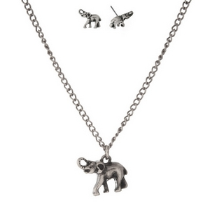 "Burnished silver tone necklace set with an elephant pendant and matching stud earrings. Approximately 16"" in length."