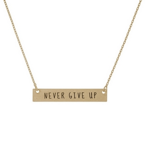 "Dainty gold tone necklace with a bar focal, stamped with ""Never Give Up."" Approximately 16"" in length."