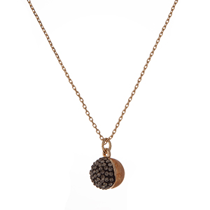 """Dainty gold tone necklace with a half beige natural stone and half hematite pave rhinestone bead pendant. Approximately 16"""" in length."""