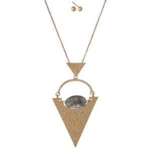 "Gold tone necklace set with a geometric pendant and gray stone. Approximately 32"" in length."