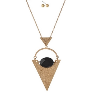 "Gold tone necklace set with a geometric pendant and black stone. Approximately 32"" in length."