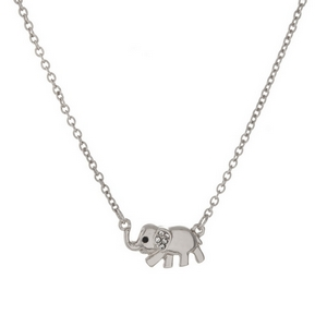 "Dainty silver tone necklace with an elephant pendant, accented with clear rhinestones. Approximately 16"" in length."