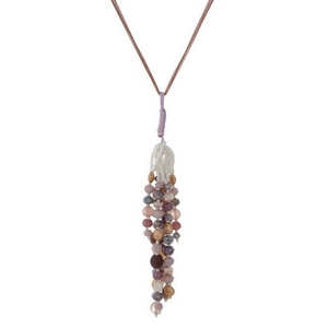 "Gold tone necklace with a pink, purple and ivory beaded tassel. Approximately 32"" in length."