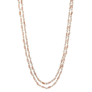 "Gold tone wrap necklace with pale pink and champagne rectangle beads. Approximately 60"" in length."