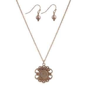 "Dainty gold tone necklace set with a flower pendant, accented by a gray stone and matching fishhook earrings. Approximately 16"" in length."