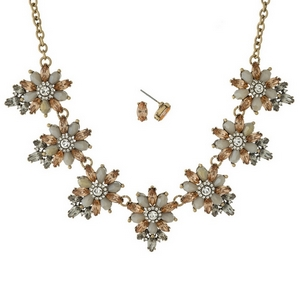 "Gold tone necklace set with peach and ivory rhinestone flowers and matching stud earrings. Approximately 16"" in length."