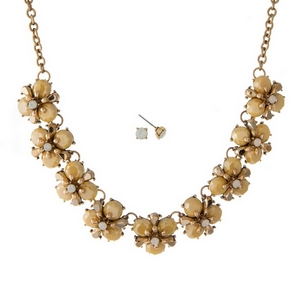 "Burnished gold tone necklace set with yellow stone flowers and matching stud earrings. Approximately 16"" in length."