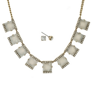 "Gold tone necklace set with pearlized white squares, accented with clear rhinestones and matching stud earrings. Approximately 16"" in length."