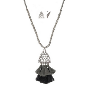 """Silver tone necklace set with gray faceted beads and a gray fabric tassel pendant. Approximately 32"""" in length."""