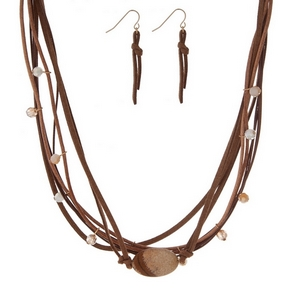 "Brown cord necklace set with a beige semi-precious stone and matching fishhook earrings. Approximately 16"" in length."