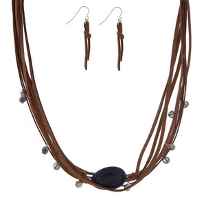 "Brown cord necklace set with a navy blue semi-precious stone and matching fishhook earrings. Approximately 16"" in length."