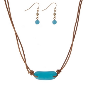 "Tan cord necklace set with a blue stone pendant and matching fishhook earrings. Approximately 14"" in length."