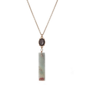 """Gold tone necklace with an amazonite natural stone pendant, accented by a gray rhinestone. Approximately 32"""" in length."""