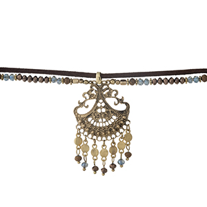 """Brown faux suede and gold tone choker with a filigree pendant, accented with brown and navy beads. Approximately 12"""" in length."""
