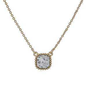 "Dainty gold tone necklace with a clear glitter pendant. Approximately 16"" in length."