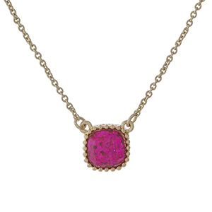"Dainty gold tone necklace with a pink glitter pendant. Approximately 16"" in length."