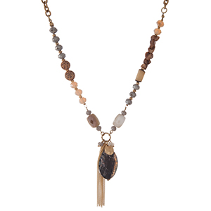 "Gold tone necklace with brown, gray and ivory beads and a black natural stone pendant. Approximately 18"" in length."