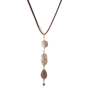 "Brown faux suede and gold tone necklace with a three neutral stone drop pendant. Approximately 16"" in length."